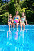 Happy family with kids having fun in swimming pool on vacation, underwater view