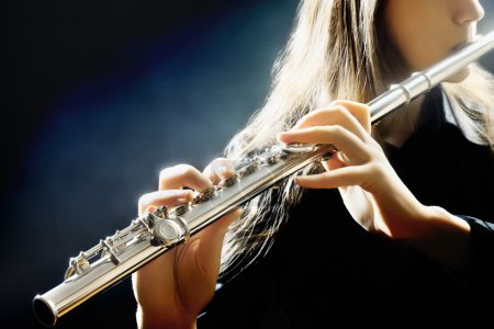 Photo for Flute music flutist instrument playing. Player hands closeup - Royalty Free Image