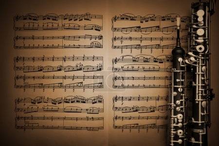 Vintage music sheet notes and oboe music instruments