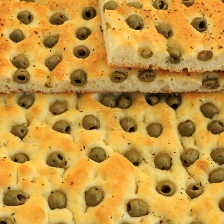 Focaccia with green olives, focaccia is flat oven baked Italia