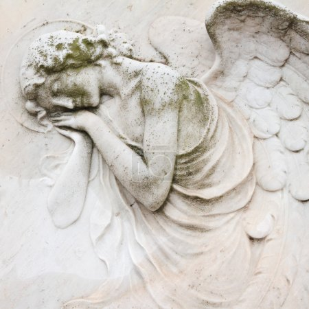 sleeping angel - antique decoration on tombstone, monumental cem