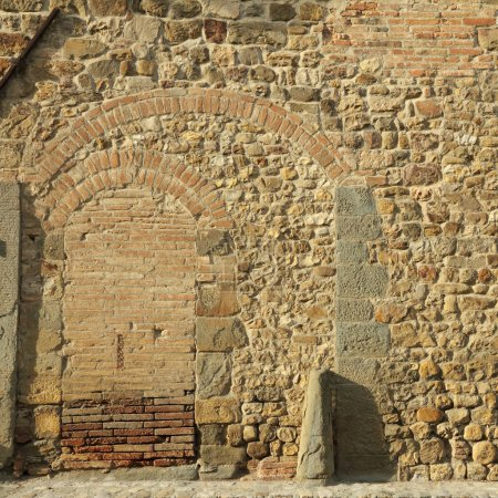 Stone and brick wall with arcs