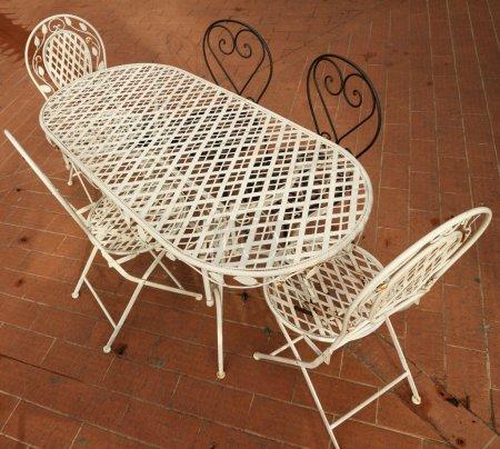 White and black ornamental metal garden furniture ...