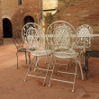 Vintage iron  garden furniture on tuscan patio, Ce...