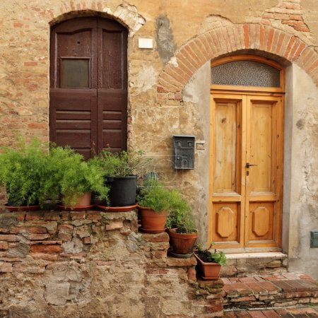 Doorsteps decorated with flowerpots  to the tuscan...