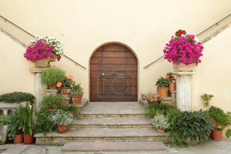 Elegant doorsteps to the italian villa decorated w...