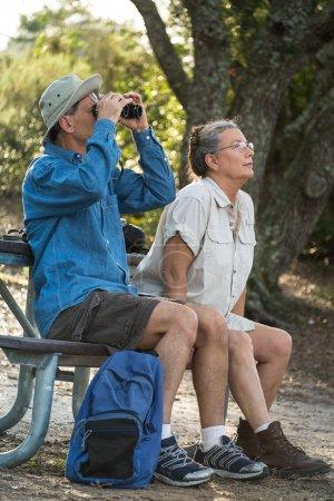 Senior Couple Hiking, Birdwatching and Camping