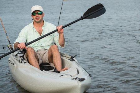 Man Fishing in Kayak closeup