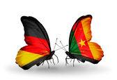 Dva motýli s příznaky na křídlech jako symbol vztahů, Německo a Kamerunu