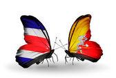 Motýli s costa rica a Bhútán vlajek na křídlech