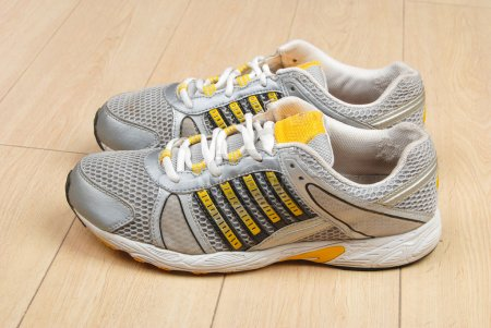 Photo for Sport shoes on floor - Royalty Free Image