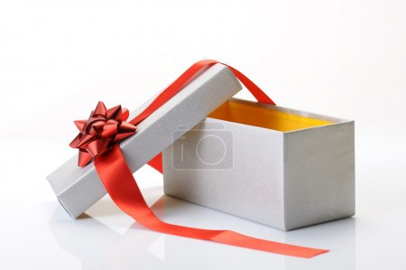 Photo for Open gift box with bow and red ribbon on white background - Royalty Free Image
