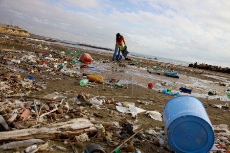 Terrible ecological disaster woman clean dirty beach