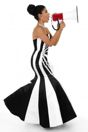 Photo for Stock image of bossy woman in formalwear using bullhorn over white background - Royalty Free Image