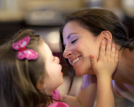 Photo for Beautiful mother and daughter share a tender moment - Royalty Free Image