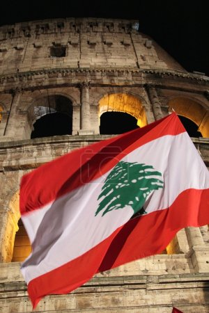 Flag of Lebanon in front of Colosseum during Way of the Cross