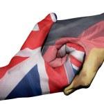 Diplomatic handshake between countries: flags of U...