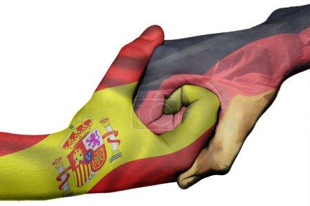 Photo pour Poignée de main diplomatique entre pays : drapeaux du Royaume-Uni et de l'Indonésie a surimprimé les deux mains - image libre de droit