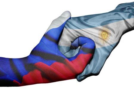 Photo pour Poignée de main diplomatique entre pays : drapeaux de la Russie et l'Argentine surimprimé les deux mains - image libre de droit