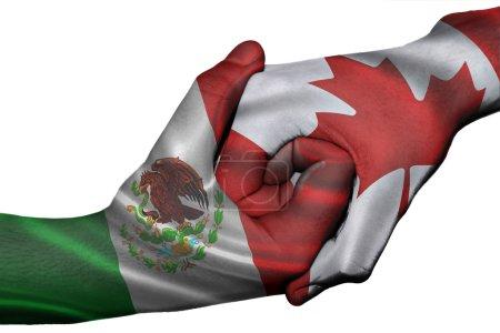 Photo pour Poignée de main diplomatique entre pays : drapeaux du canada et le Mexique a surimprimé les deux mains - image libre de droit