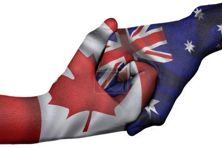 Photo pour Poignée de main diplomatique entre pays : drapeaux du canada et l'Australie surimprimé les deux mains - image libre de droit