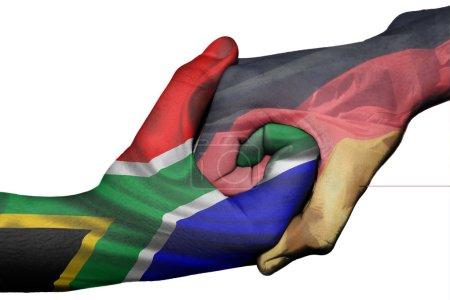 Photo pour Poignée de main diplomatique entre pays : drapeaux de l'Afrique du Sud et Allemagne surimprimé les deux mains - image libre de droit