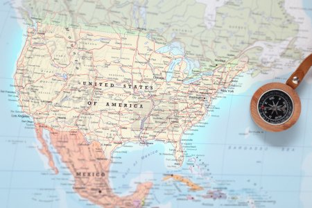 Photo for Compass on a map pointing at United States and planning a travel destination - Royalty Free Image