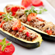 Zucchini halves stuffed with minced meat and veget...