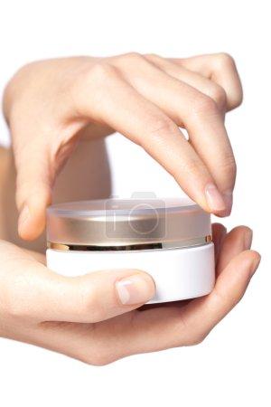 Cream box on the women hand