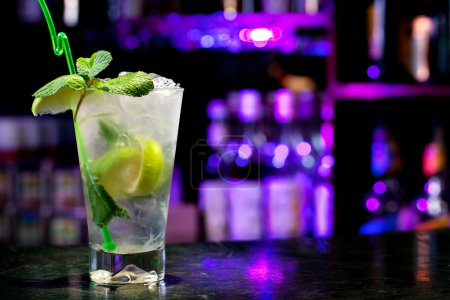 Photo for Mojito cocktail on the background of the bar - Royalty Free Image