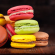 Macaroons on a wooden table...