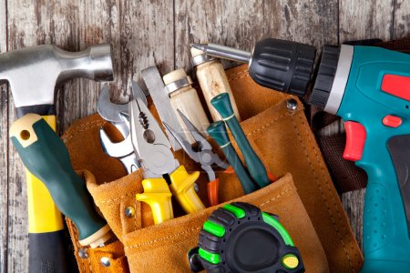Photo for Set of tools in tool box on a wooden background - Royalty Free Image
