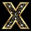 X gold letter with swirly ornaments...