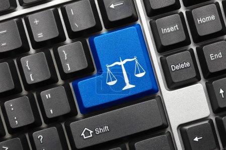 Photo pour Close up view on conceptual keyboard - Law symbol (blue key) - image libre de droit