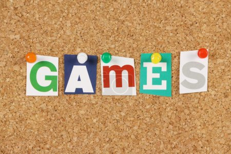 Photo for The word Games in cut out magazine letters pinned to a cork notice board - Royalty Free Image