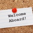 The phrase Welcome Aboard! typed onto a scrap of l...