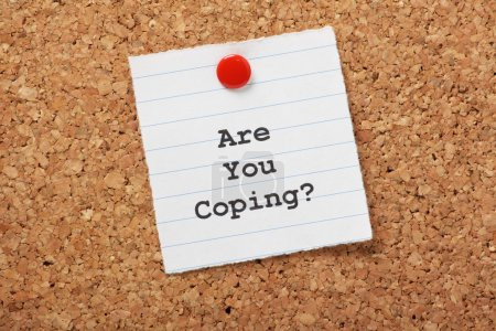 Photo for Are You Coping? on a paper note pinned to a cork notice board. An important question as we deal with increasing workloads and the stress and strain of modern living or illness. - Royalty Free Image