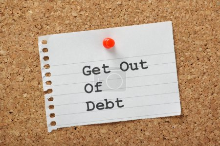 Photo for Get Out of Debt typed on a piece of lined paper pinned to a cork notice board. An aspiration for many in these times of austerity and rising costs. - Royalty Free Image
