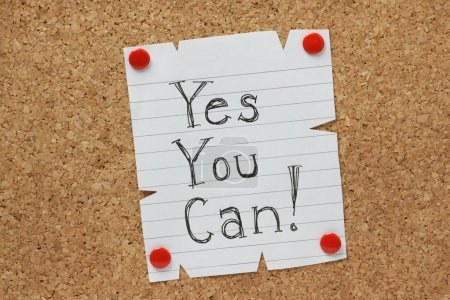 Photo for The phrase Yes You Can written by hand on a piece of paper pinned to a cork notice board - Royalty Free Image