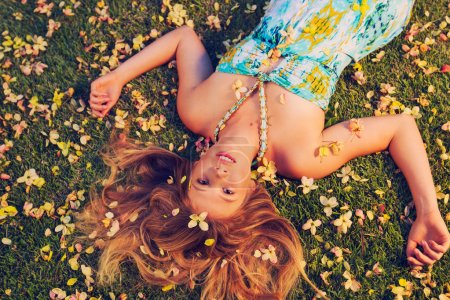 Beautiful Young Woman Lying in Flowers