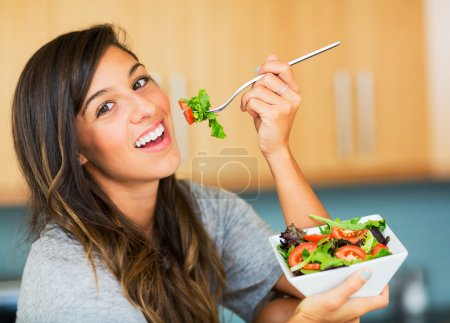Photo for Beautiful healthy woman eating salad, Dieting Concept. Healthy Lifestyle. - Royalty Free Image