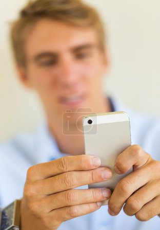 Photo for Man looking at smart phone, Texting - Royalty Free Image