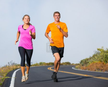 Fitness sport couple running jogging outside