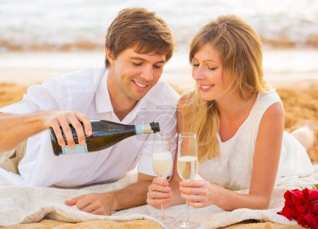 Honeymoon concept, Man and Woman in love, Enjoying glass of cham