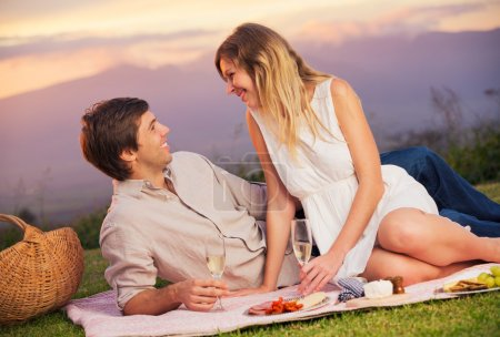 Attractive couple on romantic picnic