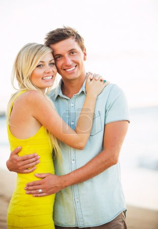 Attractive Happy Couple on the beach at Sunset, Romantic Vacatio