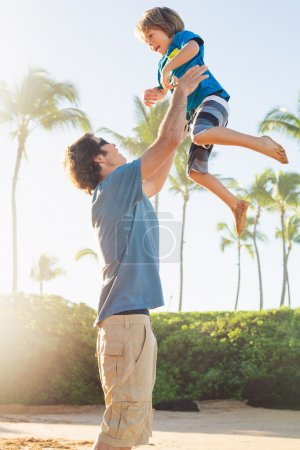 Photo for Happy father and son playing on tropical beach, carefree happy fun smiling lifestyle - Royalty Free Image