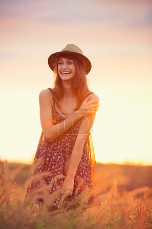Photo for Beautiful happy woman in golden field at sunset, Carefree healthy lifestyle, Vibrant color, Backlit warm tones - Royalty Free Image