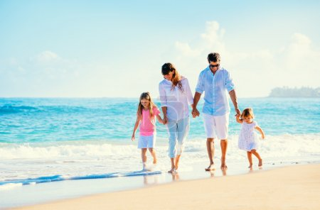 Photo for Happy family walking on the beach - Royalty Free Image
