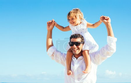 Photo for Healthy father and daughter playing together at the beach - Royalty Free Image